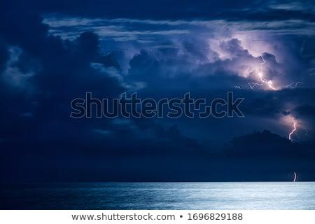 cumulus clouds in blue sky over water horizon Stock photo © lunamarina