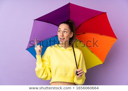 Young woman opening a purple umbrella Stock photo © photography33