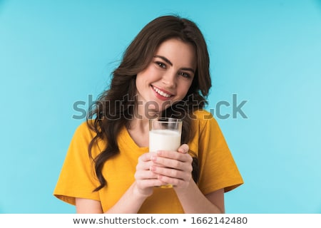 Brunette holding glass of milk Stock photo © photography33