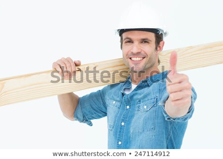 Cheerful carpenter carrying timber Stock photo © photography33