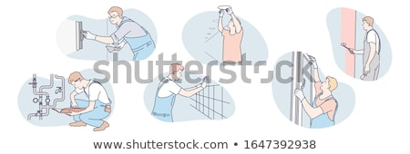 plasterer doing repairs in house Stock photo © photography33