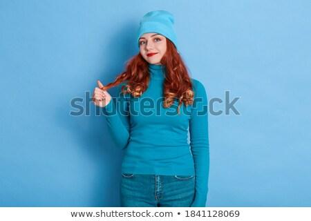 bending girl with orange hair Stock photo © dolgachov