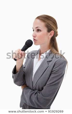 Vista lateral mulher microfone branco fundo belo Foto stock © wavebreak_media