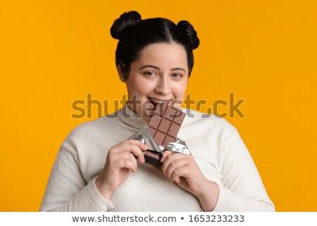 Plus size donna mangiare bar cioccolato Foto d'archivio © HighwayStarz