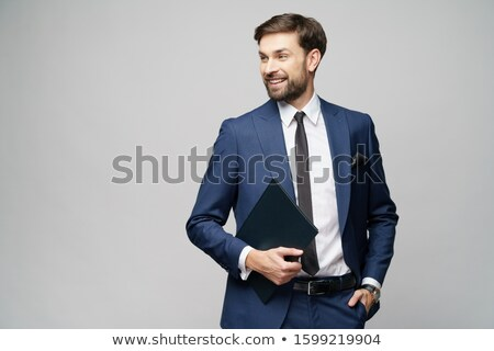 portrait of a confident businessman holding folder isolated on a white background stock photo © deandrobot