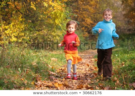 Two children run on wood autumn footpath Stock photo © Paha_L