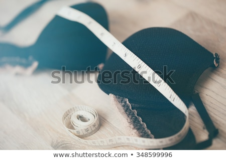 Stock photo: woman wearing underwear with tape measure