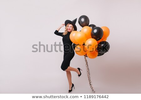 Attractive blond lady holding a bunch of shoes Stock photo © konradbak