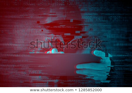 cyber attack with unrecognizable hooded hacker using tablet comp stock photo © stevanovicigor
