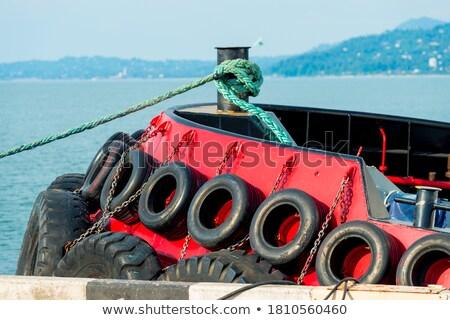 rubber tire against the boat Stock photo © Klinker