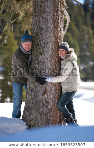 Portrait of smiling couple playing on tree trunk Stock photo © wavebreak_media