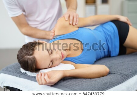 Physiotherapist giving physical therapy to the girl Stock photo © wavebreak_media