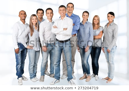 Portrait of a determined young worker looking at camera with con Stock photo © Kzenon
