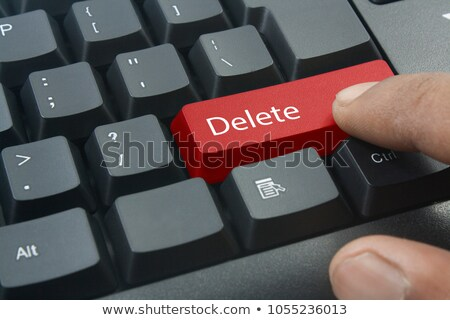 pressing red button secure payment on black keyboard stock photo © tashatuvango