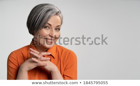 Attractive blonde woman with finger on lip smiling at camera, body care concept Stock photo © LightFieldStudios