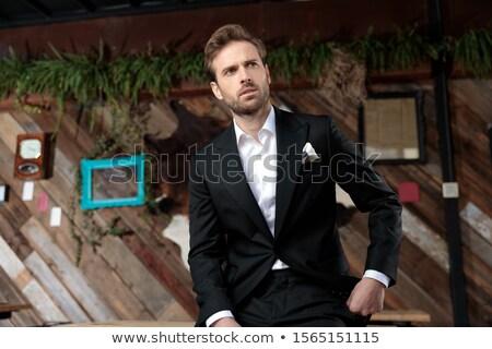 сидящий задумчивый молодым человеком открытых вид сбоку студию Сток-фото © feedough
