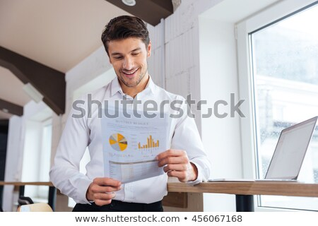 Man checking plan in an office Stock photo © IS2