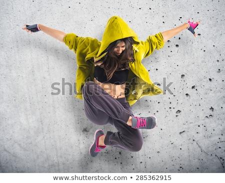 若い女の子 ジャンプ 石の壁 代 幸福 屋外 ストックフォト © IS2