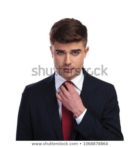 portrait of handsome businessman arranging his red tie Stock photo © feedough