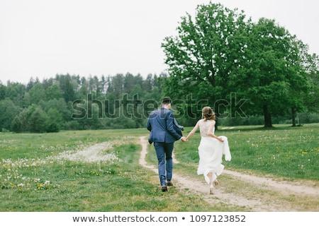 Couple holding their hand Stock photo © Kzenon