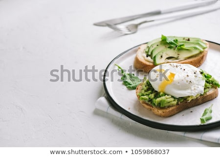 Avocado toasts with arugula Stock photo © YuliyaGontar