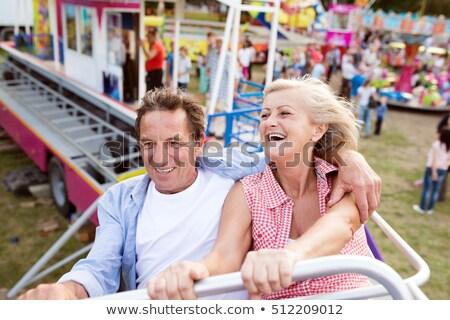 happy couple riding a rollercoaster stock photo © minervastock