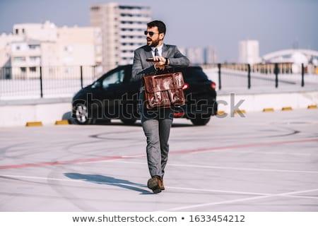 Vonzó férfi visel napszemüveg sétál parkolóhely Stock fotó © feedough