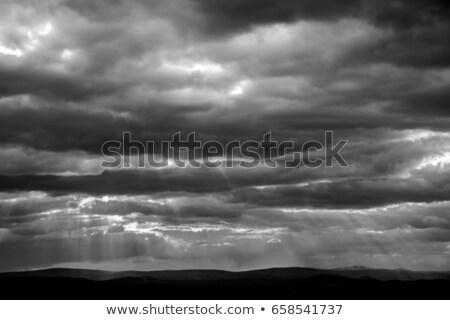 rainy clouds and sunshine light Stock photo © romvo