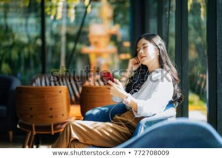 young girl relaxing in cafe stockfoto © neonshot