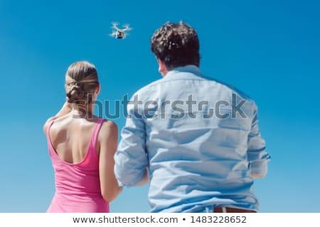 Team of drone operators working together Stock photo © Kzenon