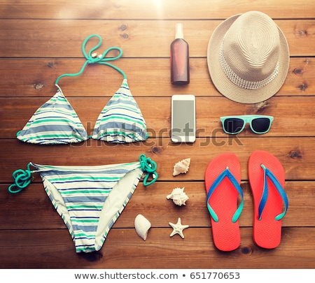 smartphone, hat, flip flops and shades on beach Stock photo © dolgachov