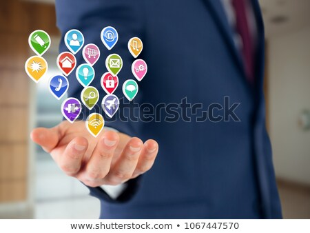businessman with hand spread of  with application icons over. Blurred office Stock photo © wavebreak_media