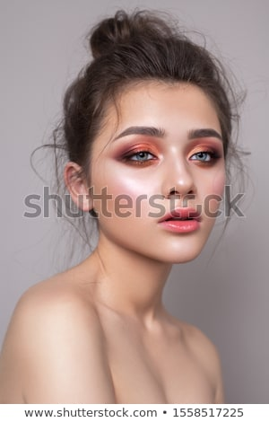 Portrait of a young bright woman with coral colored hairdress  Stock photo © dashapetrenko