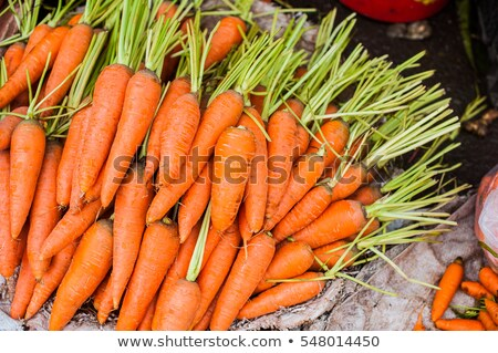 Carrot in the wicker basket on the Vietnamese market Stock photo © galitskaya