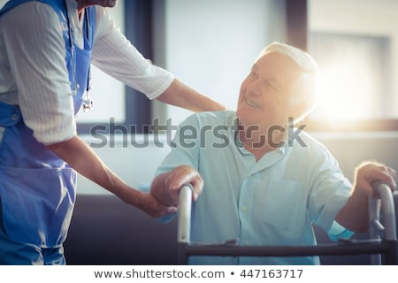 Female doctor interacting with senior woman in living room at home Stock photo © wavebreak_media