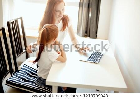 Aile iki kişi anne küçük kız ev şömine Stok fotoğraf © ElenaBatkova