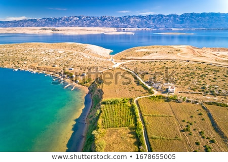 Vrsi bay and saint Lovre church ruin aerial view Stock photo © xbrchx