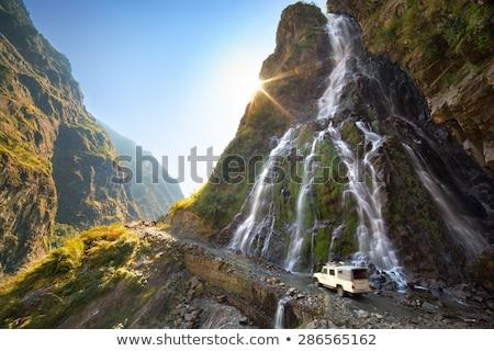 Strada sterrata himalaya valle cielo nubi montagna Foto d'archivio © dmitry_rukhlenko
