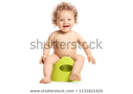 Laughing little boy sitting on potty Stock photo © erierika
