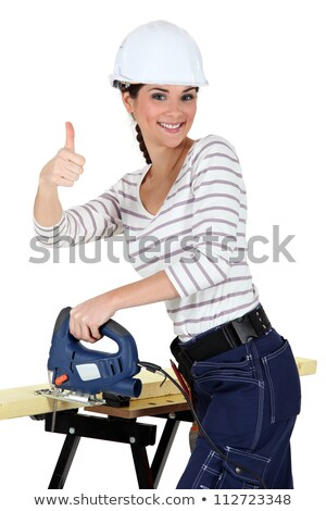 Upbeat woman using band-saw Stock photo © photography33