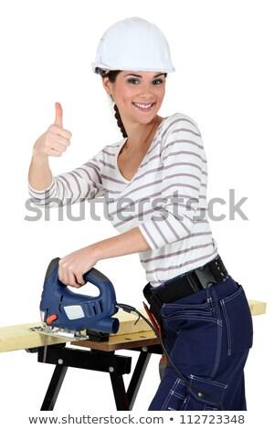 upbeat woman using band saw stock photo © photography33