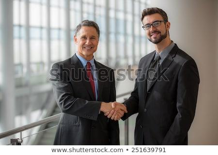 Handen schudden twee mannelijke mensen geïsoleerd witte Stockfoto © nuiiko