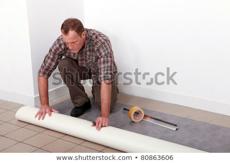 Profile view of man fitting carpet Stock photo © photography33