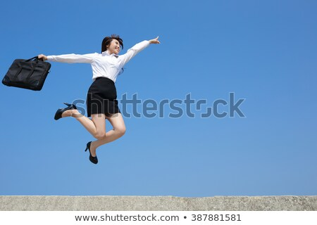 Excited businesswoman with a briefcase Stock photo © photography33