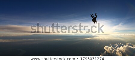 Stock photo: Sportsman jump at high above the ground