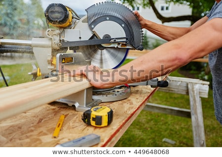 carpenter using a saw stock photo © photography33