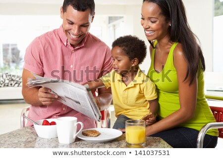 Woman having breakfast and reading newspaper Stock photo © photography33