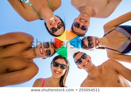 gülen · genç · kız · güneş · gözlüğü · top · plaj · deniz - stok fotoğraf © photography33