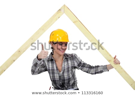 Positive female carpenter with wooden frame Stock photo © photography33