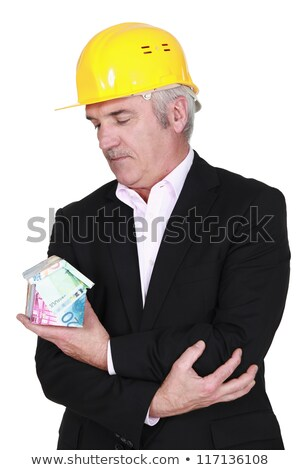 Property developer holding house made from Euros Stock photo © photography33